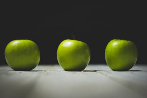 three bright green apples sitting on table - biological aspect of addiction recovery