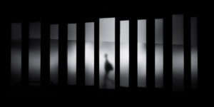 view from behind bars - black and white - addiction treatment or jail