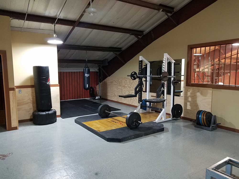 indoor gym with weights and punching bag