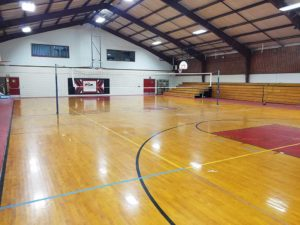 inside of gym with basketball and volleyball court