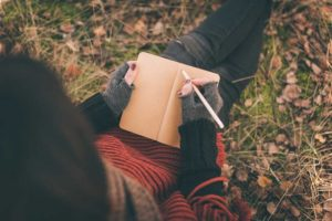 The-Wide-Variety-of-Recovery-Journaling-Options850 - girl journaling outside cool weather