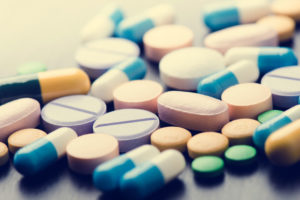 colorful variety of pills on pharmacy counter
