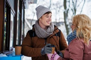 couple getting coffee outside during winter
