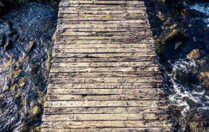 wooden bridge over rough water