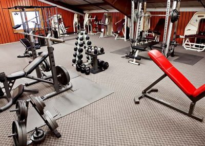 indoor weight lifting gym with free weights and machines