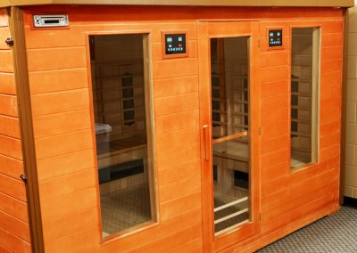 outside view of sauna with wood siding