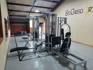 indoor gym with several weight lifting machines
