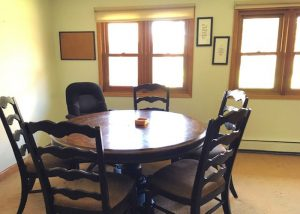 well lit room with round table and chairs - St. Gregory Recovery Center - drug and alcohol rehab in Iowa