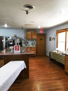 brightly lit kitchen with buffet island - St. Gregory Recovery Center