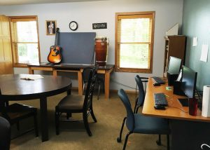 room with computers, guitar, and card table - St. Gregory Recovery Center - Iowa drug and alcohol treatment center