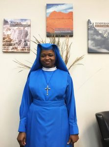 lovely African American nun in bright blue garment - St. Gregory faith based rehab
