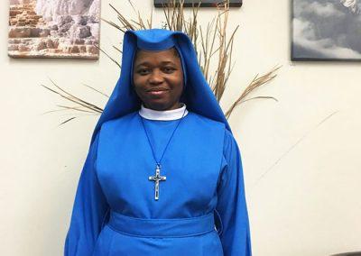 lovely African American nun in bright blue garment - St. Gregory faith based rehab