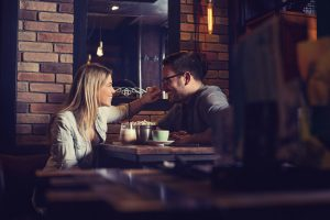 attractive couple on date at cafe - Dating While in Recovery
