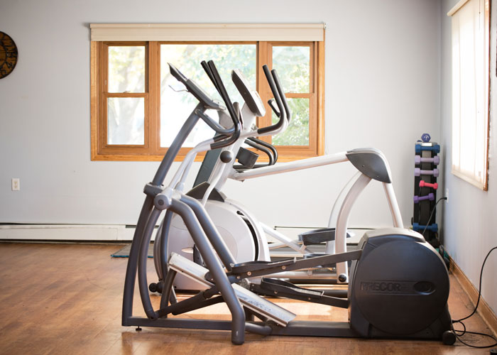 cardio machines in well lit exercise room at St. Gregory Recovery Center - Iowa drug and alcohol treatment center - co-occurring disorder treatment in Bayard, IA