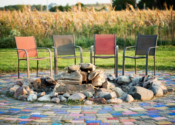 chairs around fire pit - St. Gregory Recovery Center - Iowa faith-based rehab - co-occurring disorder treatment in Iowa