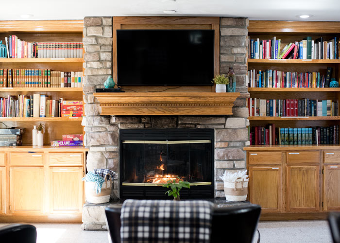 room with built-in bookshelves full of books and a fireplace - St. Gregory Recovery Center - Iowa addiction treatment center - faith-based rehab in Iowa