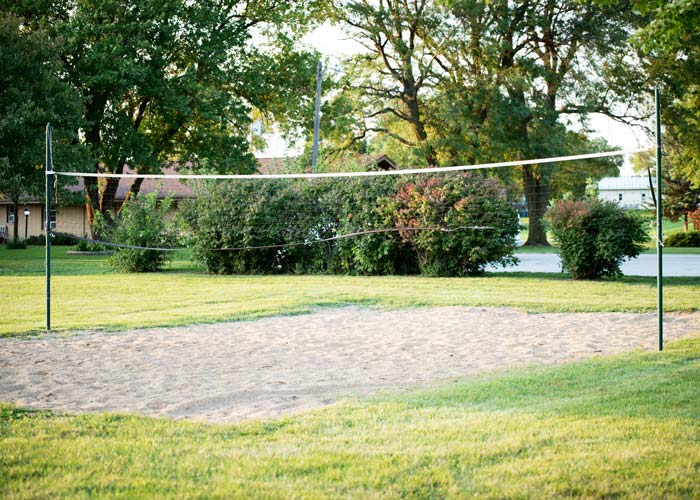 volleyball net and sand court outdoors - St. Gregory Recovery Center - Iowa substance use disorder treatment center