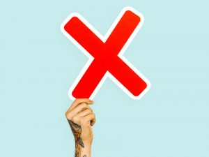 tattooed hand holding up a red X - xanax addiction