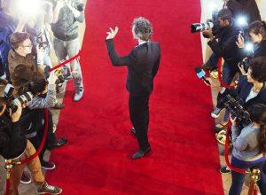 male celebrity walking down red carpet - opioid
