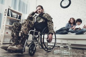 military veteran in wheelchair drinking alcohol - veterans and addiction